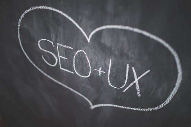 Heart with SEO + UX in the middle of it to symbolize how Toronto Web Design Company build websites